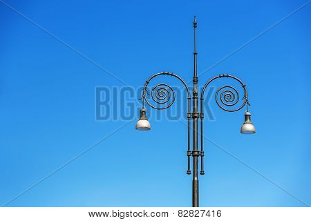 Vintage Street Lamps In The Blue Sky