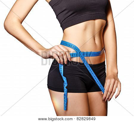 Girl measuring waist