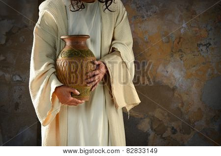 Jesus hands holding water jar ready to wash the disciples' feet