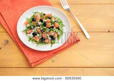 salad with arugula, cheese, basil, green onion, orange and olives.
