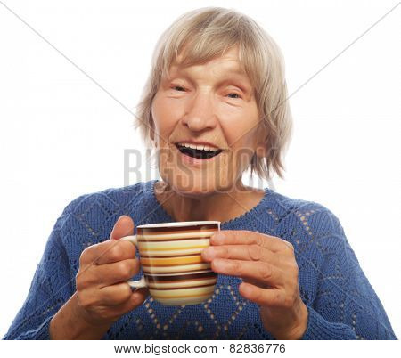 Happy old lady with coffee, isolated on white