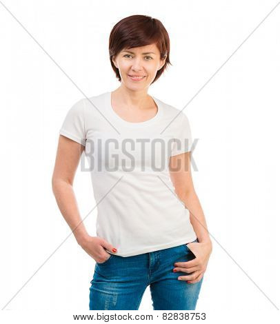 young dark-haired woman in a white T-shirt and blue jeans on a white background