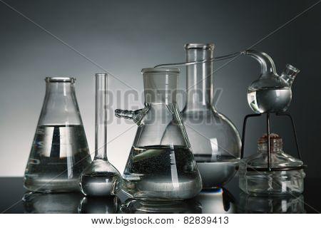 Fixed laboratory glassware on dark  background