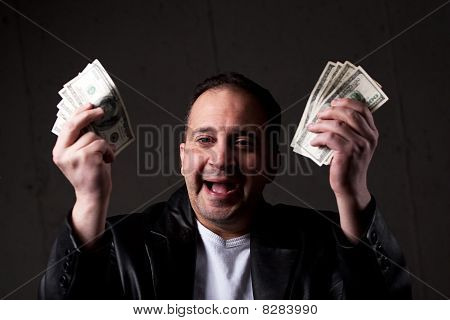Man Holding Out Money