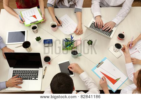 Group of business people working at desk top view