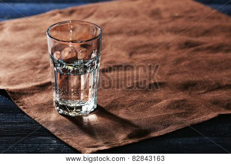Glass of water on napkin close up
