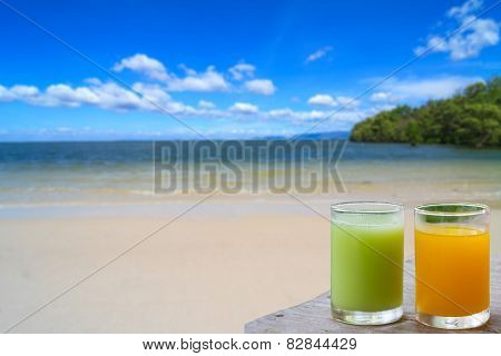 Glass of fruit juice served on the beach in thailand