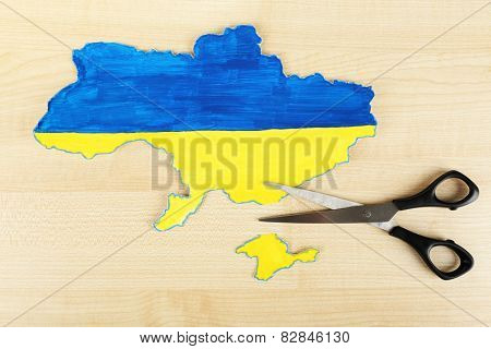 Map of Ukraine and scissors - concept of disintegration of the country