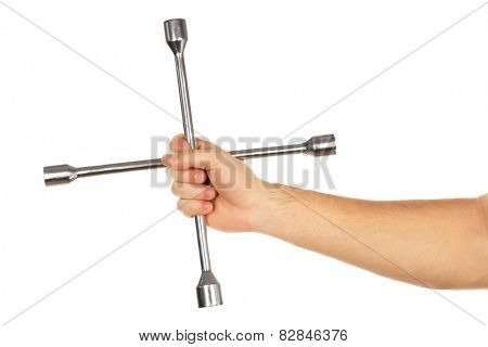 Cross wrench in male hand isolated on white