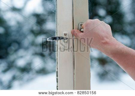 man opens old windows