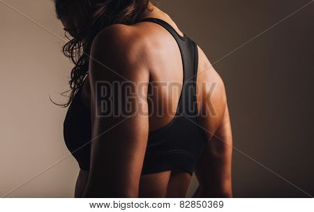 Fit And Muscular Woman In Sports Bra