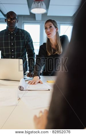 Woman Showing New Business Proposal To Coworkers