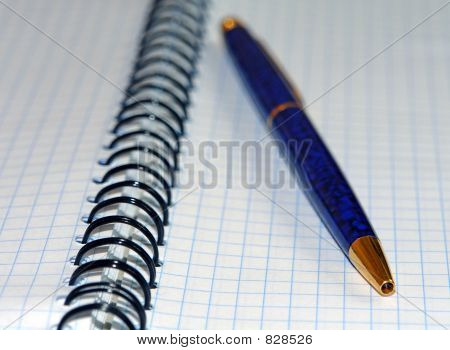 Ballpen and notebook