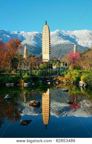 Ancient pagoda in Dali old town with lake reflection, Yunnan, China.