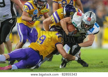 ST. POELTEN, AUSTRIA - JULY 27 RB Andreas Hofbauer (#29 Raiders) is tackled at Austrian Bowl XXVII on July 27, 2013 in St. Poelten, Austria.