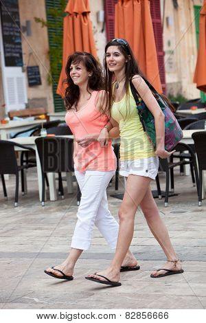 Female Friends Walking At The Street