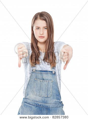 Young Teenage Girl With Thumbs Down Gesture Isolated