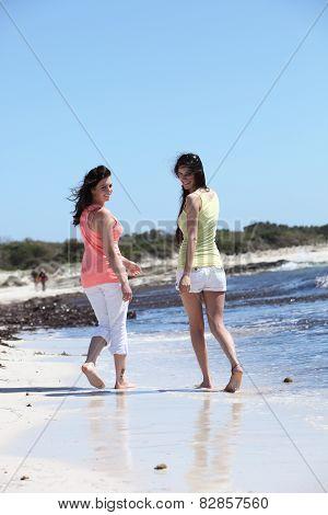 Happy Female Buddies Enjoying At The Beach