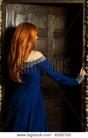 Young Woman In Renaissance Dress Open Door