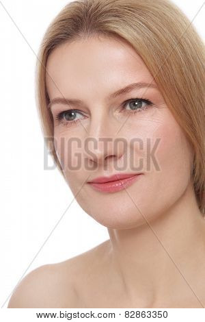 Portrait of beautiful smiling mature woman with clean make-up over white background