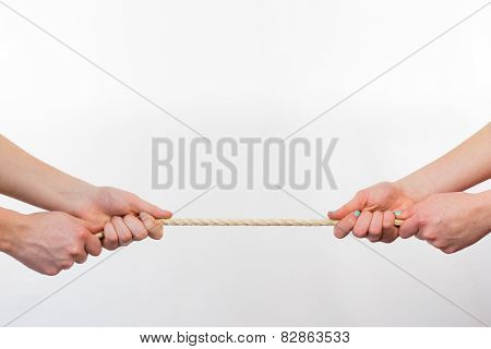 Four hands pulling rope