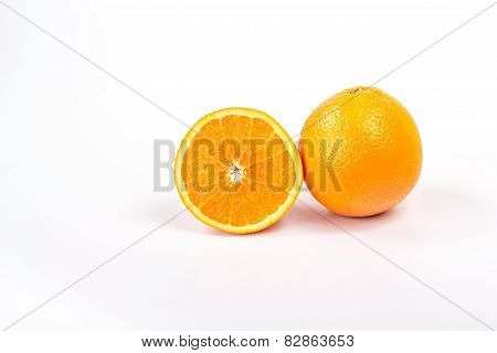 one and half orange, isolated on white background
