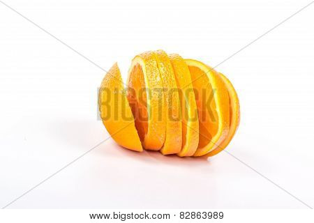 sliced juicy orange with vertical slits isolated on white background