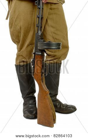 Soviet Submachine Gun At The Foot Of A Soldier
