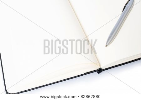 Open notebook with pen and space for your text