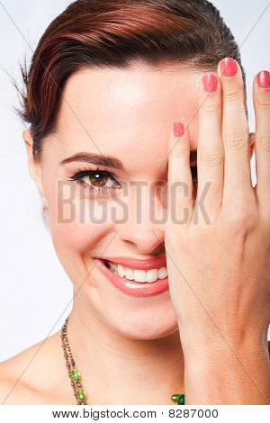 woman covering half face with hand
