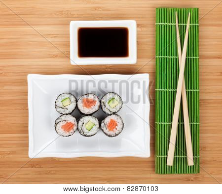 Sushi set, chopsticks and soy sauce over bamboo table