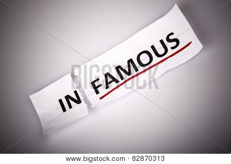 The Word Infamous Changed To Famous On Torn Paper