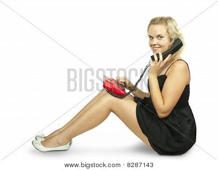 Young Woman Sitting And Talking On Phone