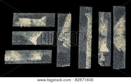 Grunge Transparent Scotch Tape On Faux Black Leather Isolated On Black