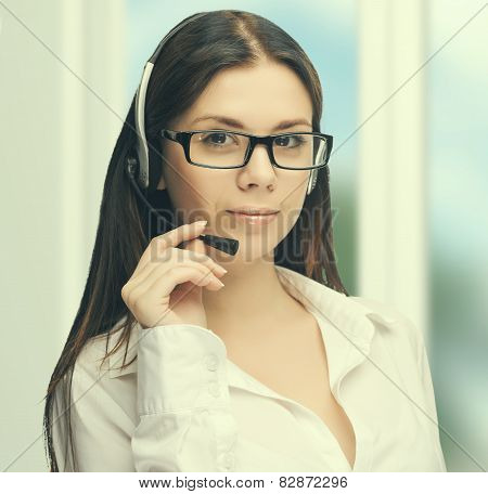 Young woman wearing headset at work at the office