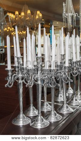 Image Of White Candles In Silver Candlesticks