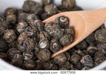 Dry Oolong Tea Leaves In Wooden Spoons