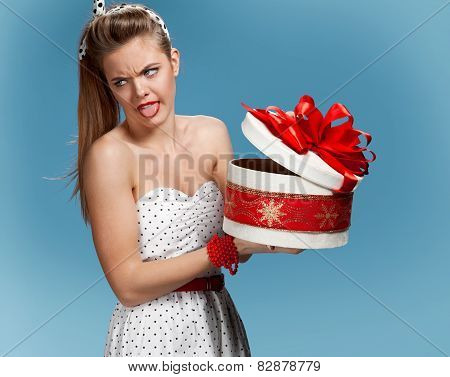 Disappointed woman with a gift box
