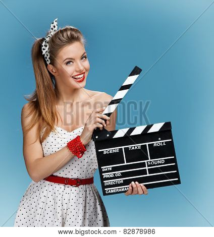 Sexy pin-up girl holding a Clapper board. Filmmaking or film production concept