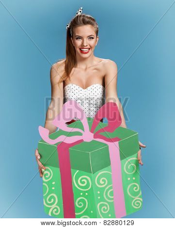 Birthday girl with large green gift box