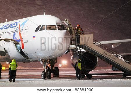Moscow, Russia, February, 09,2015: serves the ladder to the plane
