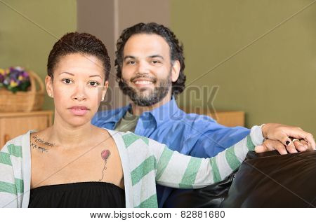 Serious Woman And Smiling Man