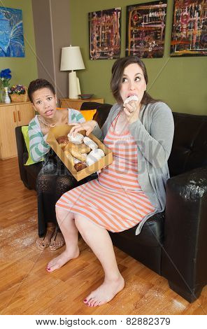 Expecting Woman Eating Sweets