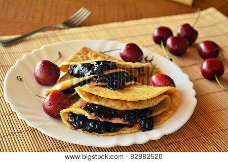 Homemade Pancakes With Jam And Fresh Cherries