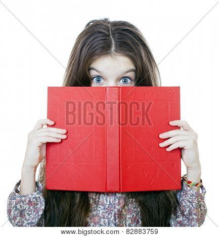 Little girl holding red book, studio on white background