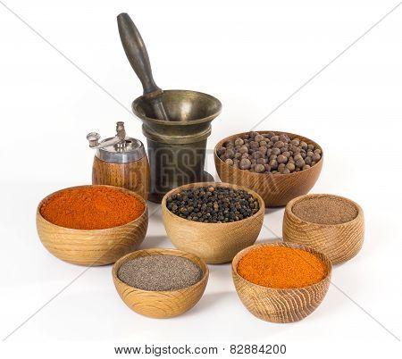 spices and seasonings in wooden bowl on white background