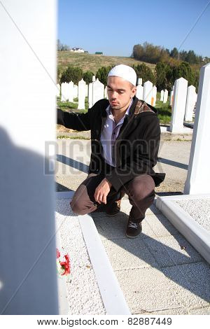 Young Muslim Man Near The His Father Grave