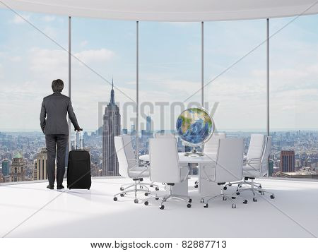 Businessman With Luggage In Office