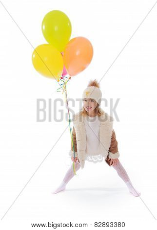 Happy girl with balloons.