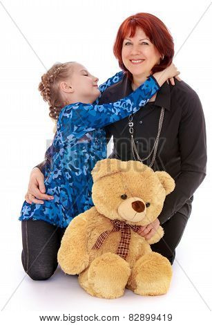 cheerful little girl hugging her beloved mother.